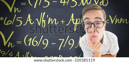 Geeky hipster thinking with hand on chin against blackboard - stock photo