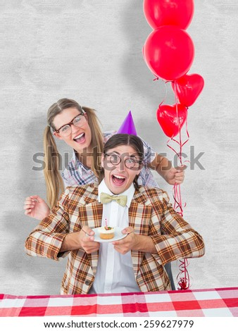 Geeky hipsters celebrating birthday against white background - stock photo