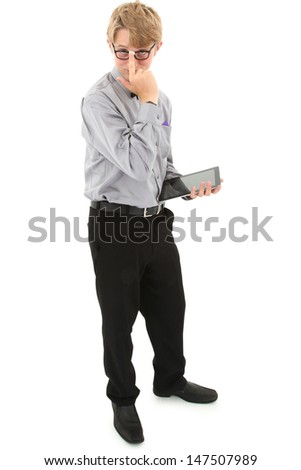 Geeky nerd teen with electronic notepad over white with clipping path.  - stock photo