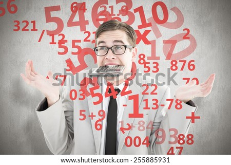 Geeky shrugging businessman biting calculator against white background