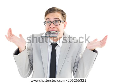 Geeky shrugging businessman biting calculator on white background - stock photo