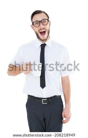 Geeky smiling businessman holding mug on white background - stock photo