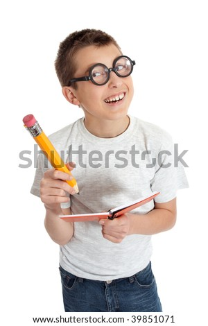 Geeky student child wearing glasses.  He is smiling and holding a notebook and oversized pencil.    PLEASE NOTE: eyeglasses are fake and are intended to make eyes look distorted. - stock photo