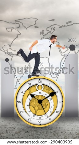 Geeky young businessman running late against global statistic on sky background - stock photo