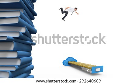 Geeky young businessman running late against stack of books - stock photo