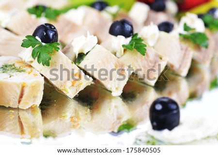 gefilte fish decorated with greenery and flowers - stock photo
