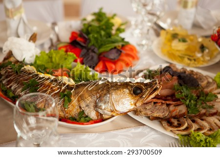 gefilte fish, vegetables and meats served on the festive table