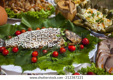 gefilte fish with tomatoes on the plate - stock photo