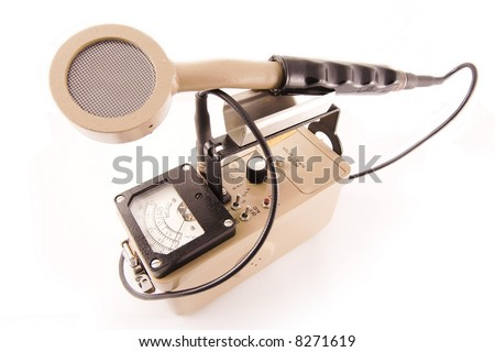 Geiger counter/surveyor with probe facing outward measuring radiation - stock photo