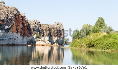 Geikie Gorge has been carved by the Fitzroy River through part of an ancient limestone barrier reef in the west Kimberley Australia.  - stock photo