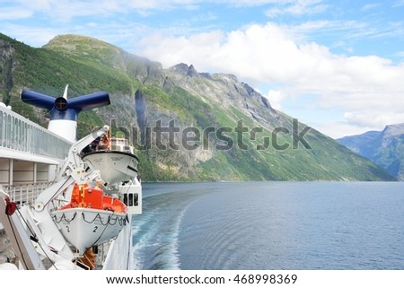Geirangerfjord  Norway -  July  31, 2016: View of Geirangerfjord  Norway from rear of cruise ship turning with fjord in background