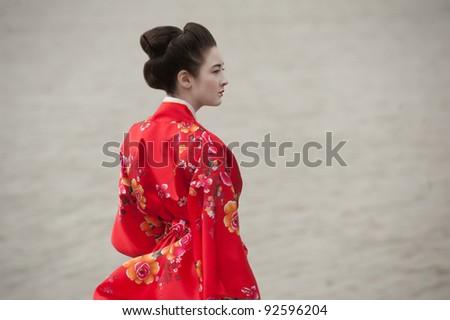 Geisha in red - stock photo