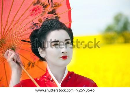 Geisha in the yellow field - stock photo