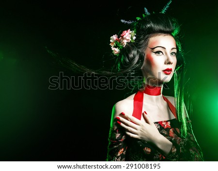 Geisha makeup and hair dressed in a kimono. The concept of traditional Japanese values. - stock photo