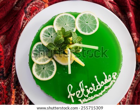 Gelatin mojito cake with lime and peppermint. Birthday cake - stock photo