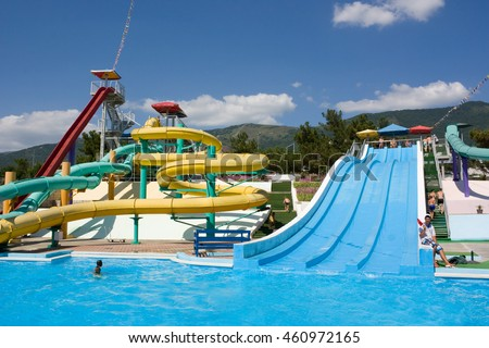 "GELENDZHIK, RUSSIA-JULY 7, 2012: Colorful water park tubes and a swimming pool in the aquapark"" Begemot"""