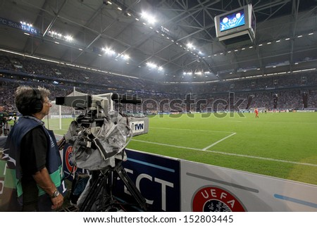 GELSENKIRCHEN, GERMANY -AUG 21: German Media and Photographers during the Uefa Champions League match Schalke 04 vs Paok on Aug 21,2013 in Gelsenkirchen, Germany.  - stock photo