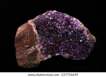gemstone, druse of purple amethyst on black background, used toning og the photo  - stock photo