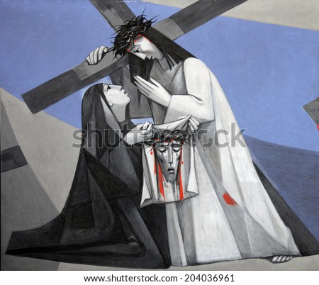 GEMUNDEN, GERMANY - JULY 18: 6th Stations of the Cross, Veronica wipes the face of Jesus, Church of the Holy Trinity on July 18, 2013 in Bavarian village of Gemunden am Main in the Diocese of Wuzburg. - stock photo