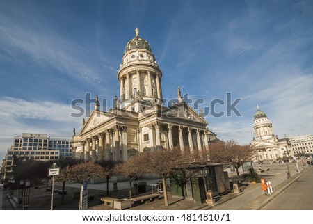 Gendarmenmarkt in Berlin, Germany with German Cathedral (Deutscher Dom) in foreground and French Cathedral (Franzosischer Dom) in background