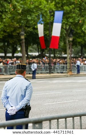 Gendarmerie during the ceremonial of french national day, Champs Elysee avenue. - stock photo