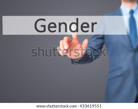 Gender - Businessman hand pressing button on touch screen interface. Business, technology, internet concept. Stock Photo