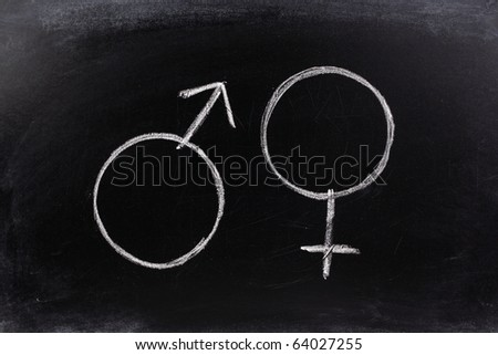 Gender symbols or signs for the male and female sex drawn on a blackboard - stock photo
