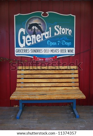 General Store sign behind bench - stock photo