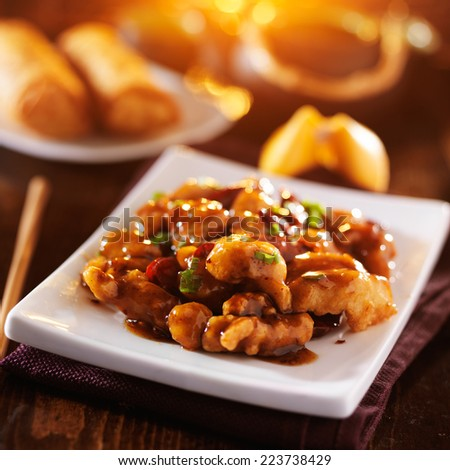 general tso's chicken with fortune cookie and egg rolls - stock photo
