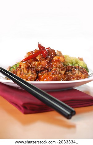 general tso's chicken with spicy chili peppers - stock photo