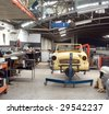 General view of a vintage cars restoration bay. - stock photo