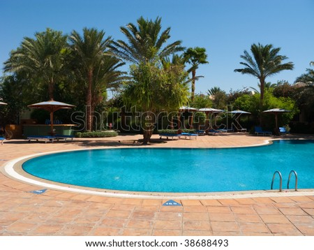 General view of the hotel pool under the blue Egypt sky