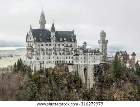 General view of the Neuschwanstein castle in the Bavaria Alps from the bridge - Tirol, Germany - stock photo