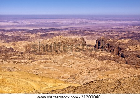 General view of the region of the historic city Petra in Jordan. The canyon at the right is called Al-Siq and leads to Petra, the ancient capital of the Nabateans kingdom - today UNESCO World Heritage - stock photo