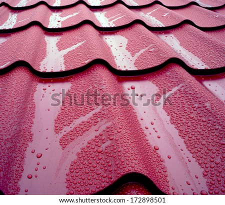 General view of wet metal roof shingles, protecting house from rain and mud