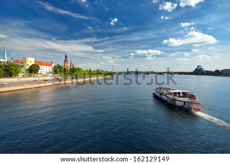 general view on Riga embankment and river ships in bright sunny  - stock photo