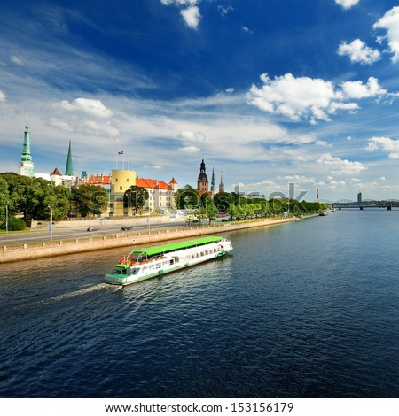 general view on Riga embarkment and river ships in bright sunny  - stock photo