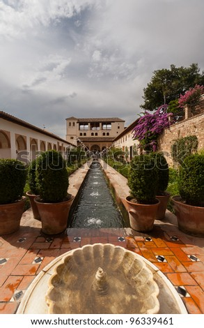 Generalife gardens of the Alhambra palace showing a water feature - stock photo