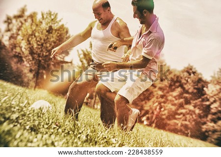 generation playing soccer together - stock photo