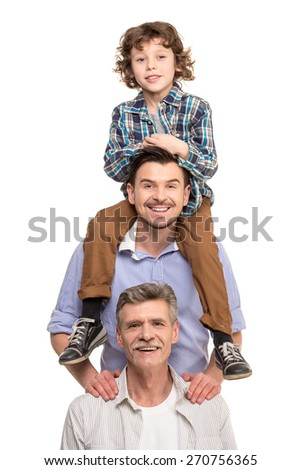 Generation portrait. Grandfather, father and son, isolated a white background. - stock photo