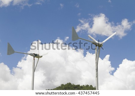 Generator from wind power with cloud and blue sky background. - stock photo