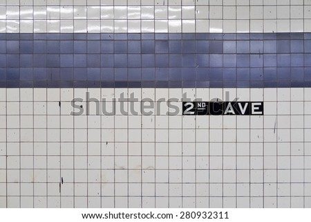 Generic abstract of old subway wall with blue tiles - stock photo