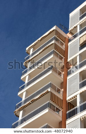 Generic apartment building in Benidorm, Spain. Residential architecture. - stock photo