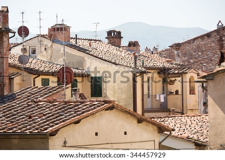 Generic architecture in the ancient Walled City of Lucca, Tuscany, Italy - stock photo