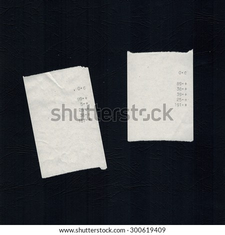 generic bill receipts with costs shown - isolated over black background - stock photo