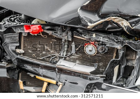 Generic compact car damaged in a rollover accident. Car crash wreck - stock photo