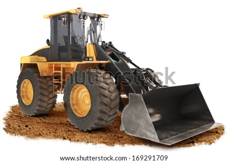 Generic construction bulldozer loader excavator construction machinery equipment  positioned on dirt with a white background - stock photo
