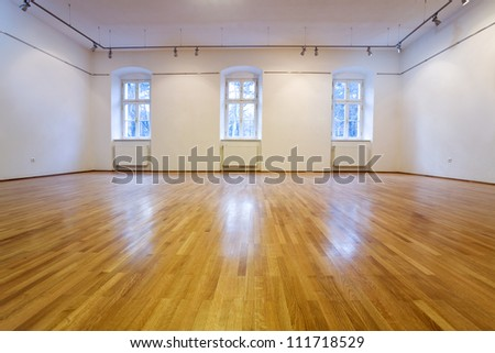 Generic empty exposition room with wooden floor- lots of copy space - stock photo