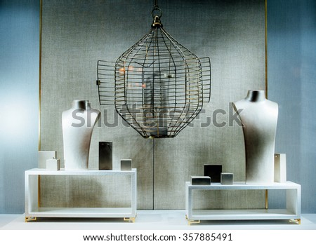Generic empty jewelry store show-window with a two dummy torso, an empty cage and no gems or gold - stock photo