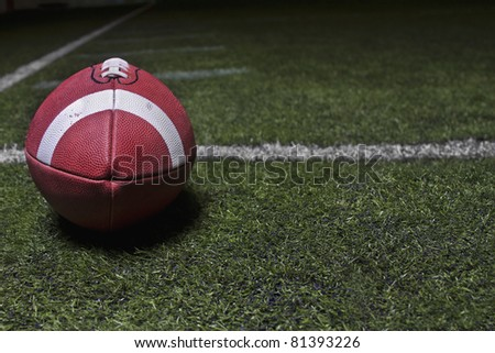 Generic Football background on a turf field - stock photo